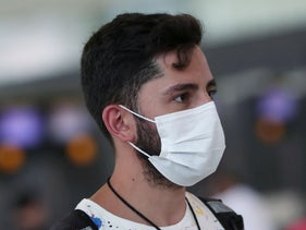 Travelers wearing masks are seen at Guarulhos International Airport in Guarulhos, Brazil, February 3, 2020.