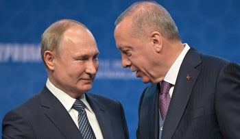 Recep Tayyip Erdogan and Vladimir Putin during a ceremony for a dual natural gas line connecting Russia and Turkey, in Istanbul, January 8, 2020.