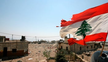 A Lebanese flag flies over Khiam prison, in the southern town of Khiam, Lebanon,on August 16, 2006.