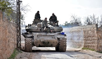 Syrian government troops gathering in an area southwest of Saraqeb during their assault on Idlib, Syria, February 3, 2020.