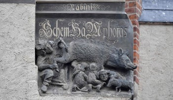 A medieval anti-Semitic carving depicting Jews suckling the teats of a sow as a rabbi looks intently under its leg and tail in Wittenberg, eastern Germany, October 31, 2017.