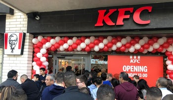 People line up in front of the new KFC branch on opening day in Nazareth, February 3, 2020.