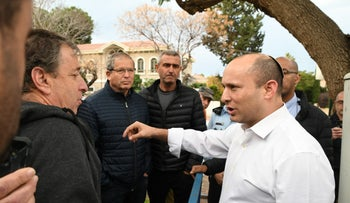 Israel's Defense Minister Naftali Bennett speaks with Israeli cattle ranchers during a protest against the ongoing Palestinian Authority ban on the import of calves from Israel.