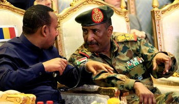 Lieutenant General Abdel Fattah Al-Burhan, talks to Ethiopian Prime Minister Abiy Ahmed in Khartoum, Sudan, August 17, 2019.