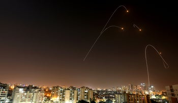 A rocket being intercepted by Israel's missile defense system over the southern city of Ashkelon, November 13, 2019