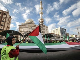 A giant Palestinian flag during a demonstration against Trump's Middle East peace proposal in Khan Yunis, Gaza Strip, February 3, 2020