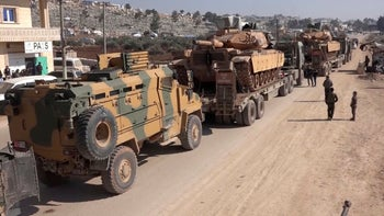 In this frame grab from video, a Turkey Armed Forces convoy is seen at the northern town of Sarmada, in Idlib province, Syria, February 2, 2020.