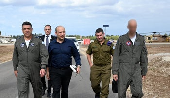 The base commander, Defense Minister Bennett, and the Air Force Commander Norkin, at Hatzor airbase in December.