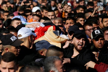 The funeral of the Palestinian policeman killed in Jenin.