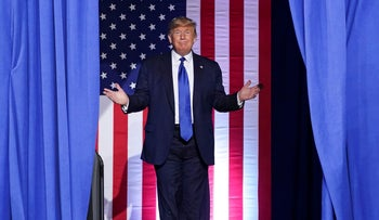 Donald Trump arrives for a campaign rally in Milwaukee, Wisconsin,  January 14, 2020.