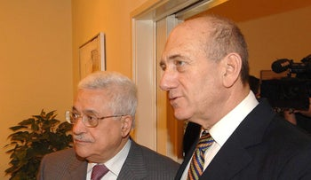 File photo: Mahmoud Abbas and Ehud Olmert in 2008.