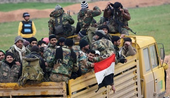 Syrian Army soldiers advance in Tall Sultan town towards Saraqeb city, in Syria's northwestern Idlib province, on February 5, 2020.