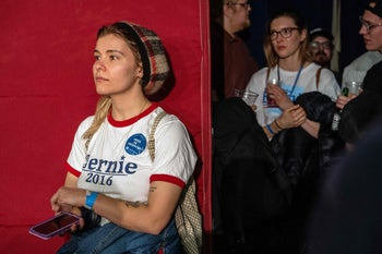 Supporters of Bernie Sanders waiting to hear caucus results on Monday in Des Moines.