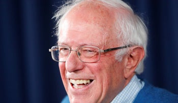 Democratic presidential candidate Sen. Bernie Sanders smiles while speaking during a news conference at his New Hampshire headquarters, February 6, 2020.