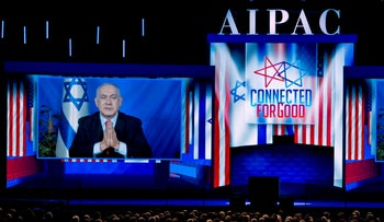 Netanyahu speaks on a video from Israel to the 2019 American Israel Public Affairs Committee (AIPAC) policy conference in Washington, on Tuesday, March 26, 2019.