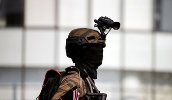 A soldier exits Terminal 21 shopping mall after completing their mission following a gun battle involving a Thai soldier on a shooting rampage, in Nakhon Ratchasima, Thailand February 9, 2020.