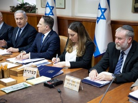 Benjamin Netanyahu and Attorney General Avichai Mendelblit, right, at a cabinet meeting in Jerusalem, February 9, 2020.