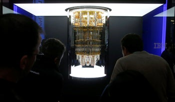 CES patrons take a look as IBM unveils this quantum computer, Q System One, shown here during the CES tech show in Las Vegas, Nevada, United States, January 8, 2020.