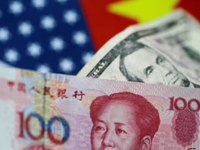 U.S. Dollar and China Yuan notes are seen in this picture illustration, June 2, 2017.