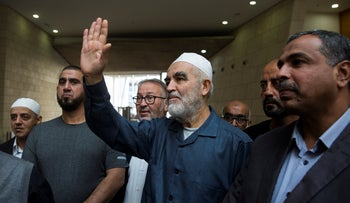 Raad Saleh greets supporters before his indictment at the Haifa Magistrate's Court, November 24, 2019.