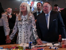 Sheldon Adelson and wife Miriam stand as U.S. President Donald Trump delivers remarks at the Israeli American Council National Summit in Hollywood, Florida, U.S., December 7, 2019.