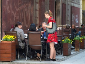 A waitress is seen in a photo taken for illustrative purposes only.