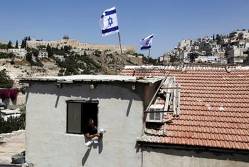 A house in Silwan neighborhood of east Jerusalem Thursday, Aug. 27, 2015 where activists from the Ateret Cohanim settler organization moved into the building taken from Palestinians.