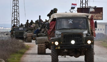 Syrian government forces deploy in the Damascus-Aleppo highway in the southern part of Syria's northern Aleppo province on February 10, 2020.