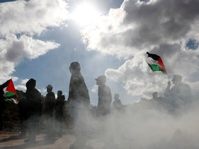Palestinian demonstrators take part in an anti-Israel protest in al-Mughayyir village near Ramallah, in the Israeli-occupied West Bank, January 3, 2020.