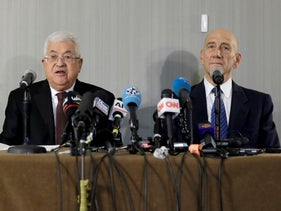 Palestinian President Mahmoud Abbas, left, speaks while former Israeli Prime Minister Ehud Olmert listens during a news conference in New York, Tuesday, February 11, 2020.
