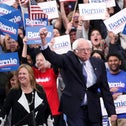 Democratic presidential candidate Sen. Bernie Sanders, I-Vt., with his wife Jane O'Meara Sanders, arrives to speak to supporters at a primary night election rally in Manchester, N.H., Tuesday, Feb. 11, 2020
