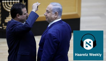 Prime Minister Netanyahu, right, and Joint List leader Ayman Odeh in the Knesset in 2019.