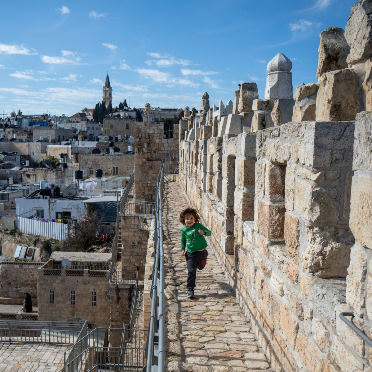 A child on the Ramparts Walk in Jerusalem's Old City, February 2020.