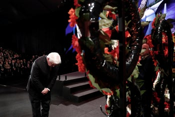 German President Frank-Walter Steinmeier takes part in a wreath-laying ceremony at the World Holocaust Forum in Jerusalem on January 23.