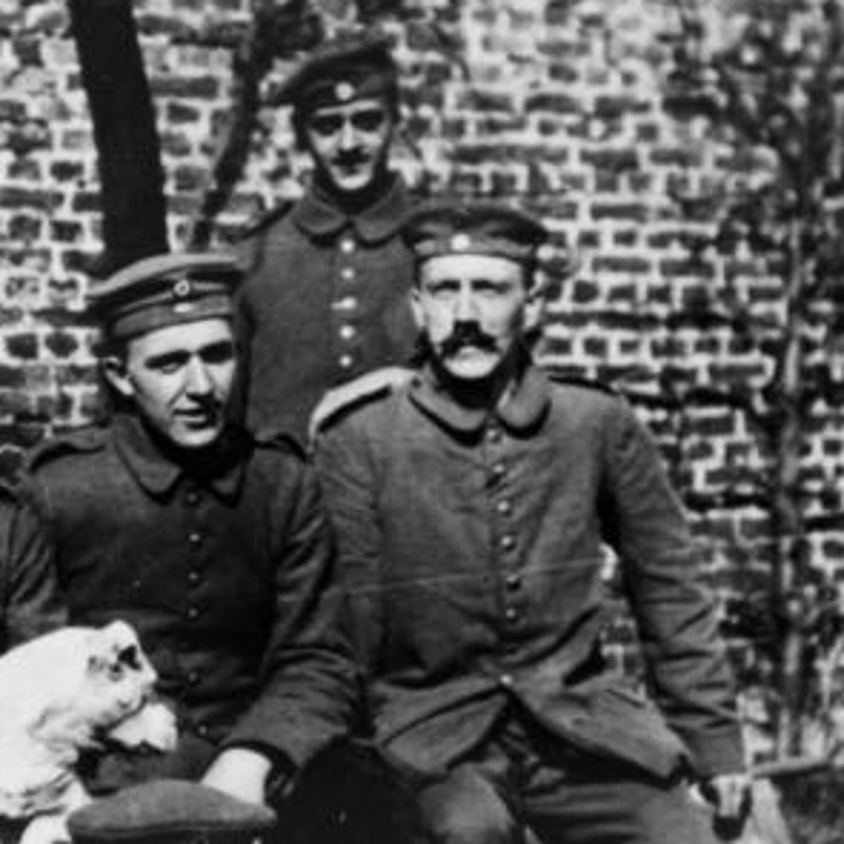 A young Adolf Hitler with his WWI comrades of the Bavarian Reserve Infantry Regiment 16, 1914-1918.