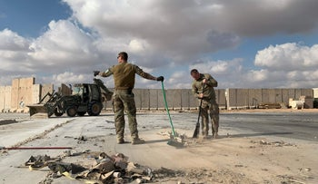 American soldiers clearing rubble at the Ain al-Asad military base in Iraq.