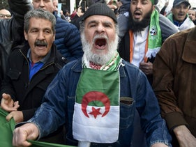 Algerian protesters chant as they take part in an anti-government demonstration in the capital Algiers, on January 31, 2020.