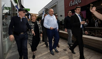 Avigdor Lieberman, center, leader of the Yisrael Beiteinu, party, walks during election campaign tour in a shopping mall in the Port city of Ashdod, Israel, on Friday, February 14, 2020.