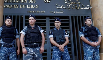 Lebanese police stand outside the entrance of the Association of Banks in downtown Beirut, Lebanon November 1, 2019.