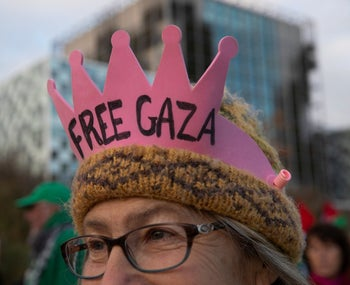 A demonstrator wears a crown outside the ICC during a demonstration urging the court to prosecute Israel's army for war crimes in The Hague, Netherlands, on Friday, November 29, 2019.