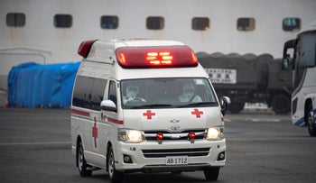 Ambulance workers leave the quarantined Diamond Princess cruise ship, as the vessel's passengers continue to be tested for coronavirus, south of Tokyo, Japan February 16, 2020.