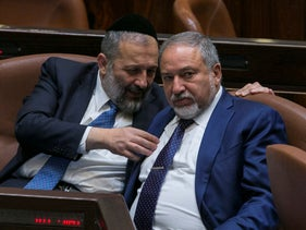 Arye Dery (L) and Avigdor Lieberman in the Knesset, Israel, January 12, 2018