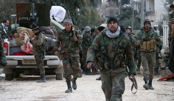 Members of the Syrian army deploy in the al-Rashidin 1 district, in Aleppo's southwestern countryside, on February 16, 2020