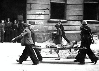 A 1944 photo showing soldiers from the Polish Home Army carry their wounded comrade, during the 1944 Warsaw Uprising against the Nazis