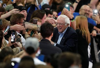Democratic presidential candidate Sen. Bernie Sanders, I-Vt., greets supporters in Denver after a campaign stop late Sunday, February 16, 2020.