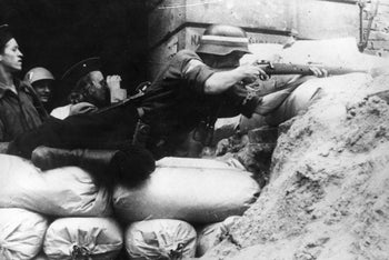Warsaw Uprising in Poland, 1944. Polish Home Army soldiers defending a barricade
