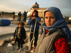 Syrian children as their families prepare to flee a camp for the displaced, in the north of the northwestern Idlib province, February 16, 2020.