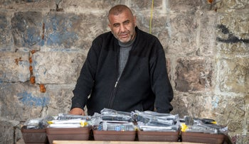 Kamal Abu Quider, a familiar figure on social media in Jerusalem, working at a stand he owns in East Jerusalem, February 16, 2020.
