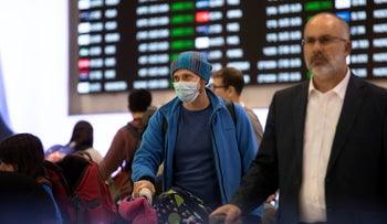 A traveler in a face mask at Israel's Ben-Guiron International Airport, February 17, 2020.