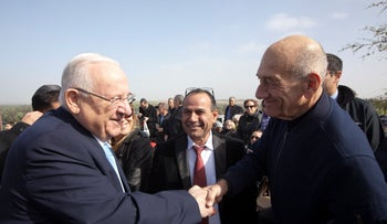 President Reuven Rivlin and former Prime Minister Ehud Olmert at the annual memorial ceremony for Ariel Sharon, May 7, 2019.